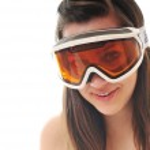 Woman with ski googles isolated on white — Stock Photo