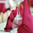 Restaurant table with empty wine glass - Stock Photo