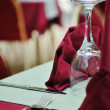 Restaurant table with empty wine glass — Stock Photo
