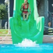 Girl have fun on water slide at outdoor swimmin — Stock Photo #1679253