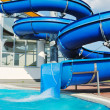 Water slide fun on outdoor pool — Stock Photo
