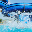 Water slide fun on outdoor pool — Foto de Stock