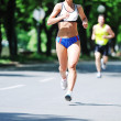 Marathon woman run — Stock Photo