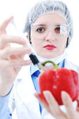 Doctor with red papper — Stock Photo