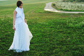 Beautiful bride outdoor after wedding ceremny — Stock Photo