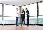 Happy young couple buying new home — Stock Photo