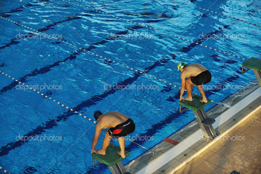 Start position race concept with fit swimmer on swimming pool  Stock Photo #1671715