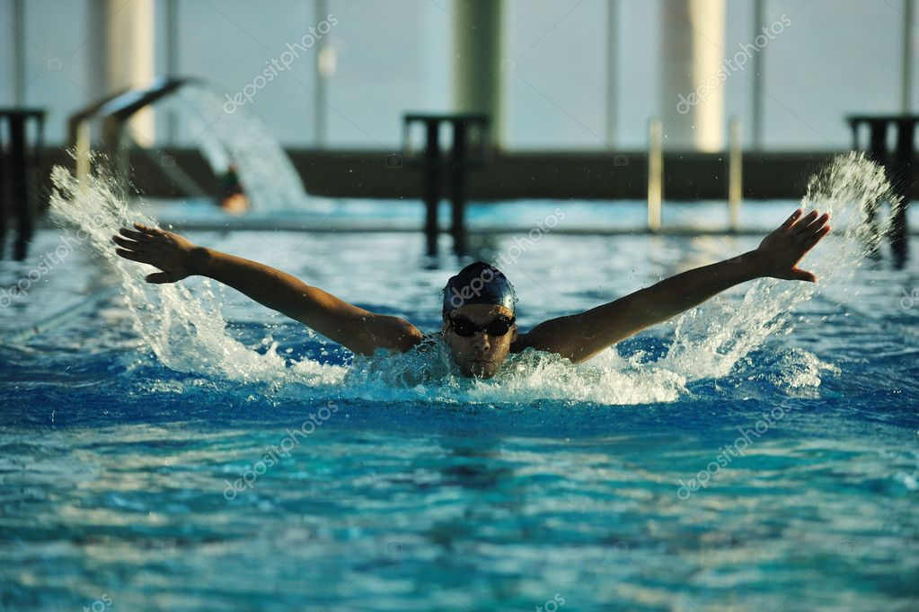 Health and fitness lifestyle concept with young athlete swimmer recreating  on olimpic pool  Stock Photo #1672026