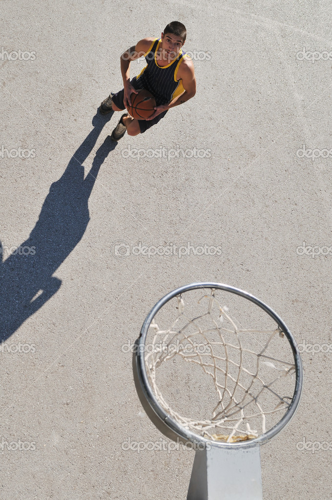 Group of young boys who playing basketball outdoor on street with long shadows and bird view perspective — Stock Photo #1673093