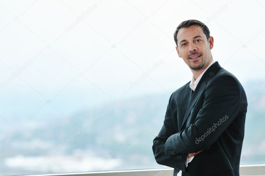 Happy young business man portrait in suit  with isolated blured background  — Stockfoto #1674075