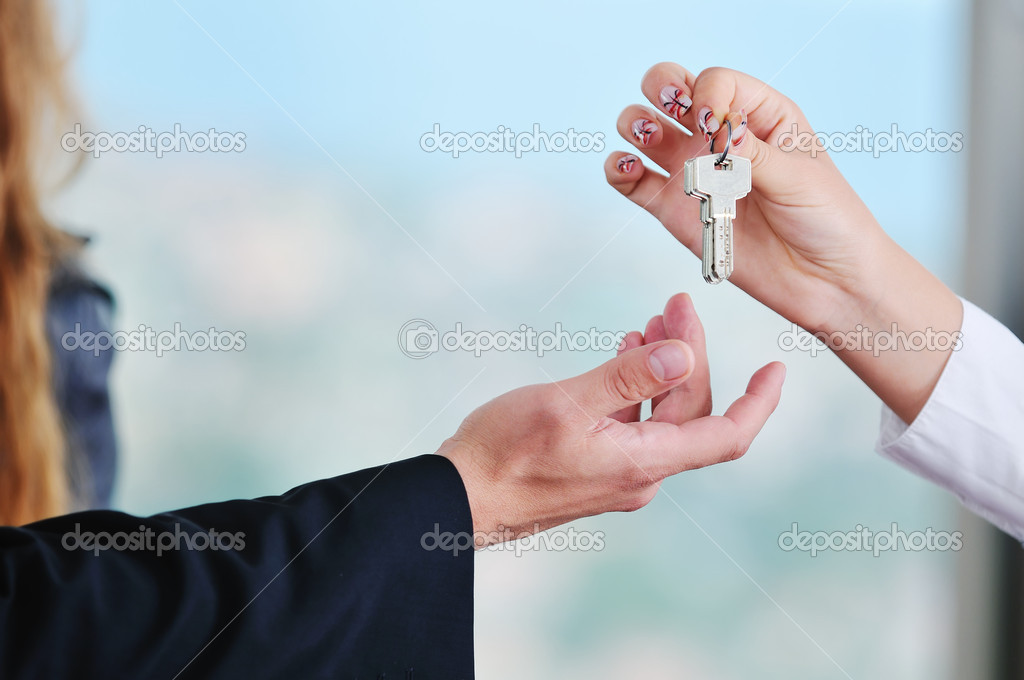 Man and woman hand closeup with home keys representing buying and selling new apartment and real estate concept  — Stock Photo #1674123