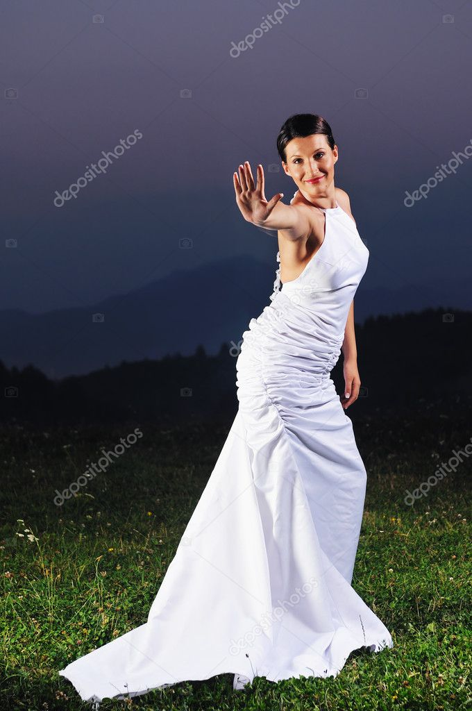 Happy young beautiful bride after wedding ceremony event have fun on meadow in fashionable wedding dress  Stock Photo #1675434