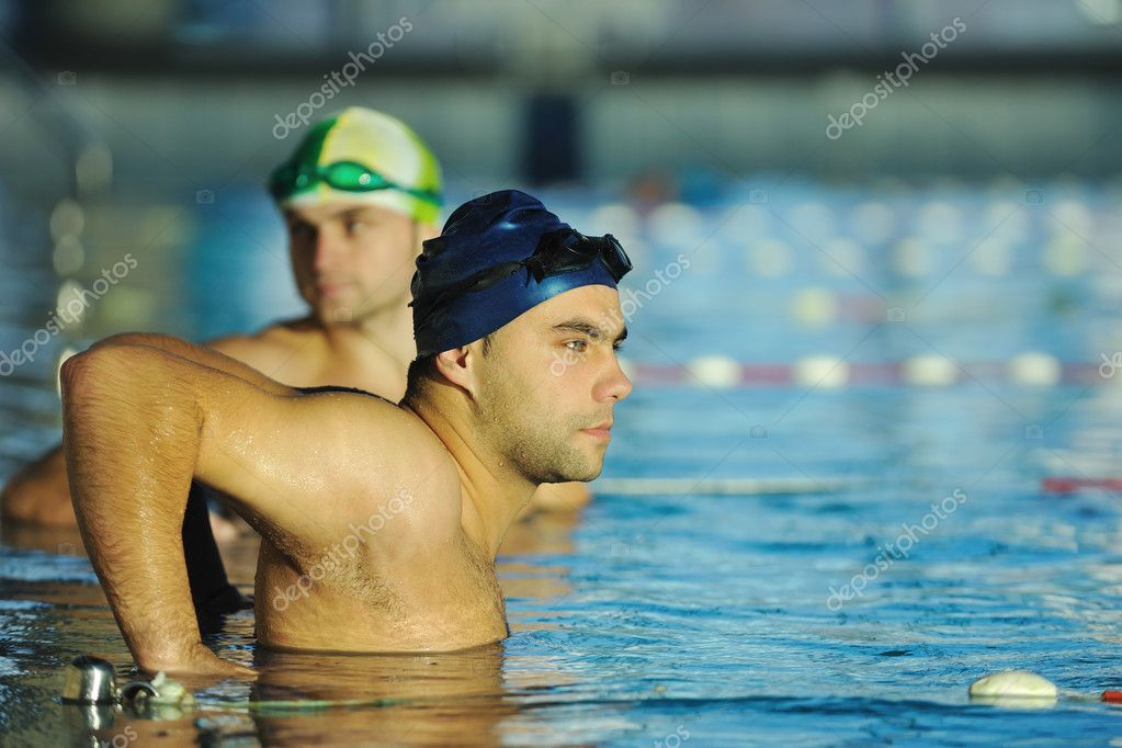 Win competiotion and swimming race concept with two freiend who handshaking in pool  Stock Photo #1675465