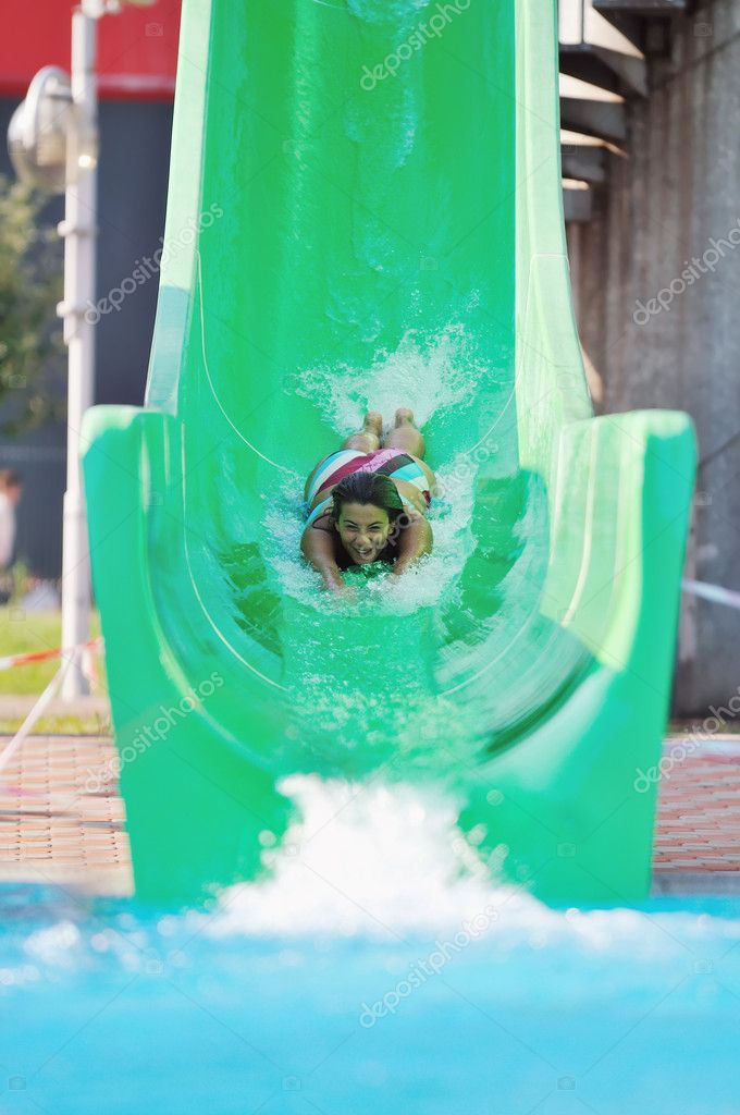 Girl Have Fun On Water Slide At Outdoor Swimmin Stock Photo Shock 1679306