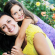 Happy mom and daughter outdoor — Stock Photo #1680309