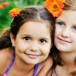Two happy girls have fun outdoor - Stock Photo