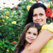 Happy mom and daughter outdoor — Stock Photo #1680592