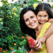 Happy mom and daughter outdoor — Stockfoto