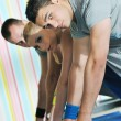 Young adults group in fitness club — Stock Photo #1680606