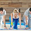 Young adults group in fitness club — Stock Photo