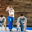 Young adults group in fitness club — Stock Photo #1680689