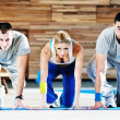 Young adults group in fitness club — Stock Photo #1680751