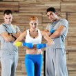 Young adults group in fitness club — Stock Photo #1680787
