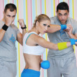 Young adults group in fitness club — Stock Photo #1680807