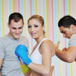 Young adults group in fitness club - Stock Photo