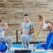 Young adults group in fitness club — Stock Photo #1680921