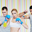 Young adults group in fitness club — Stock Photo #1680933