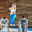 Young adults group in fitness club — Stock Photo #1680978