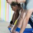 Young adults group in fitness club — Stock Photo #1682473
