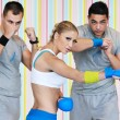 Young adults group in fitness club — Stock Photo #1682823