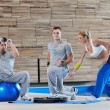 Young adults group in fitness club — Stock Photo #1682867