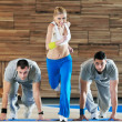 Young adults group in fitness club — Stock Photo #1683091