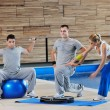 Young adults group in fitness club — Stock Photo #1683178