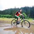 Royalty-Free Stock Photo: Wet mount bike ride