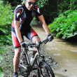 Wet mount bike ride — Stock Photo