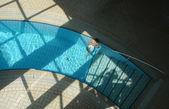 Happy child play on pool — Stock Photo