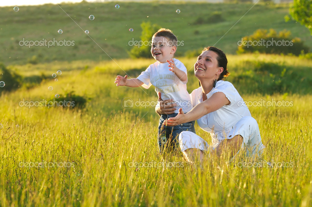 Happy young woman mother play and outdoor with beautiful child  — Stock Photo #1681296