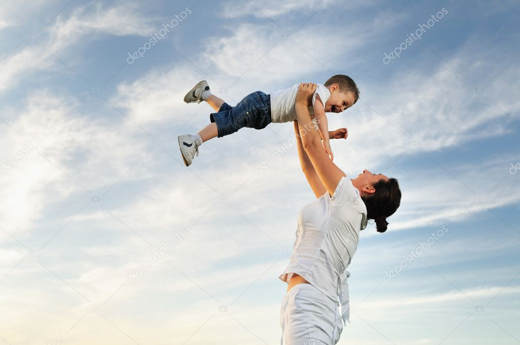 Happy young woman mother play and outdoor with beautiful child   Stock Photo #1681782