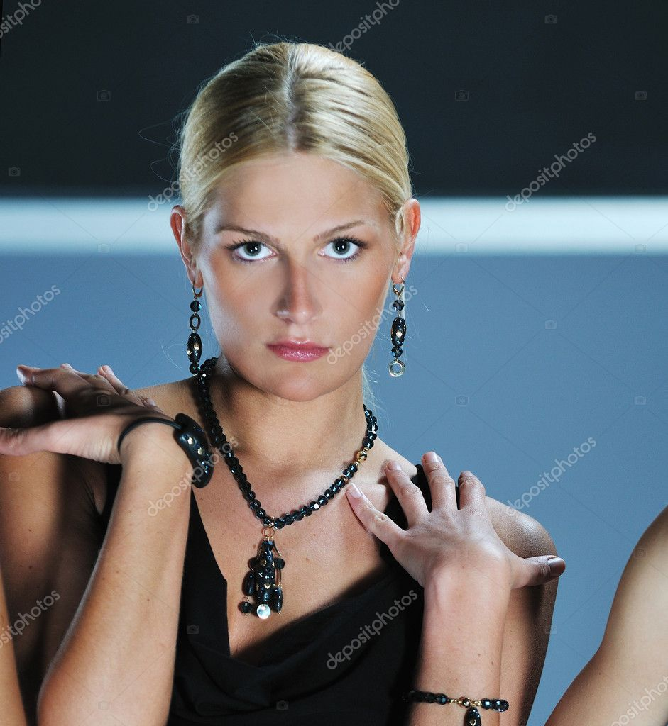 Beautiful woman on fashion show piste with gold jawel — Stock Photo #1682522