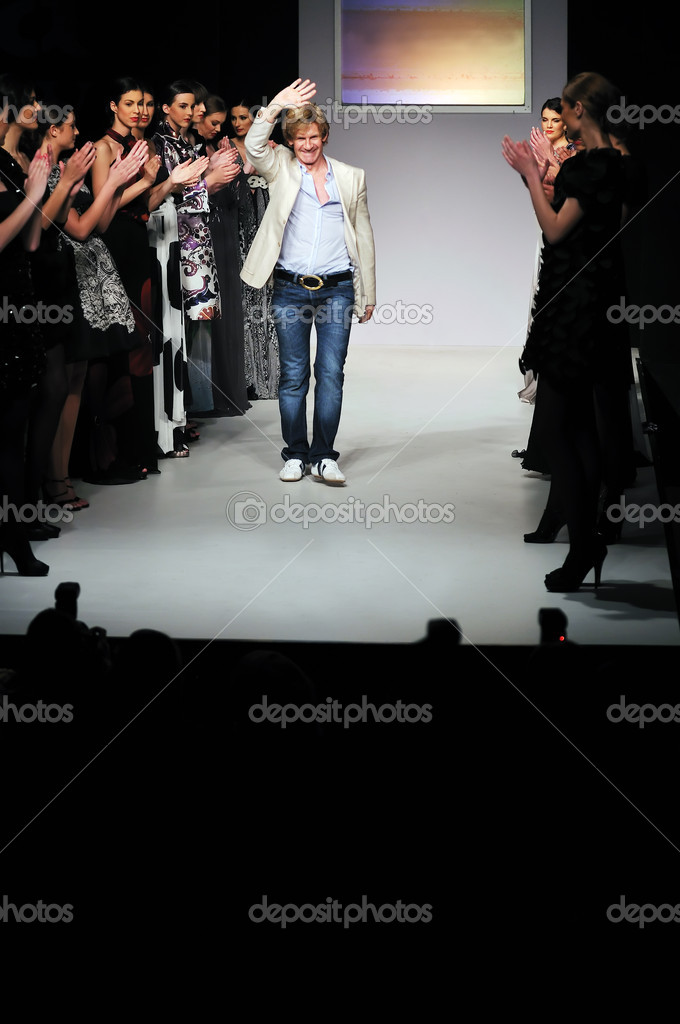 Young successful fashion designer on the end of fashion show — Stock Photo #1684302
