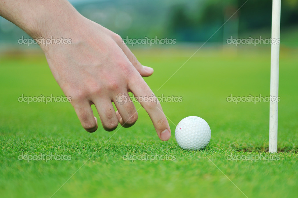 Golf ball on sports golf course and hole — Stock Photo #1686542
