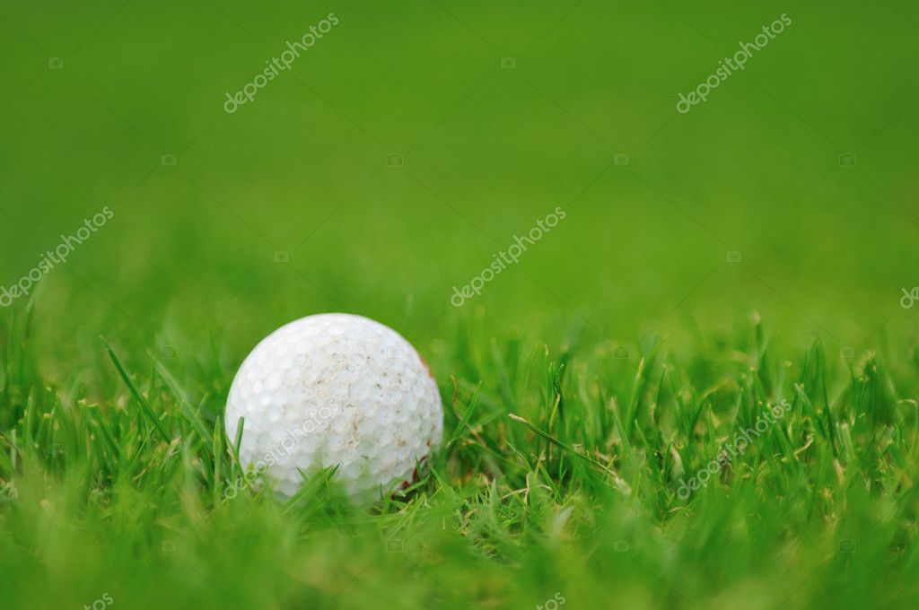 Golf ball on sports golf course and hole — Stock Photo #1686554