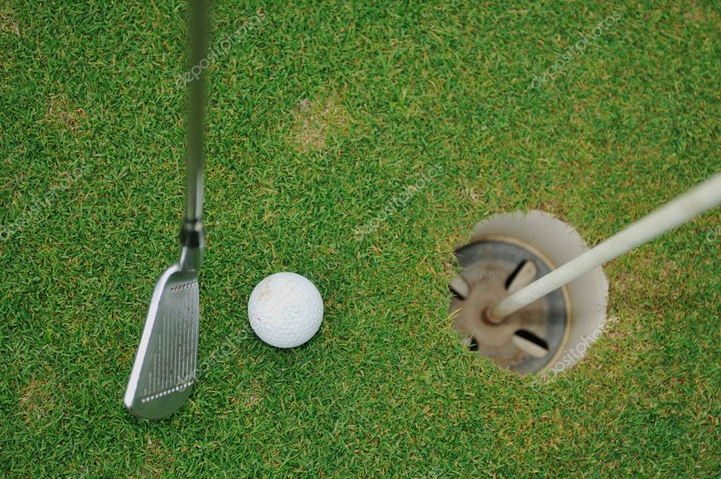Golf ball on sports golf course and hole — Stock Photo #1686586