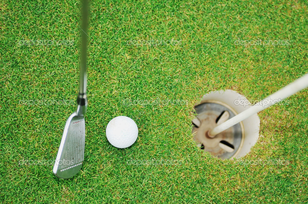 Golf ball on sports golf course and hole — Foto de Stock   #1687711