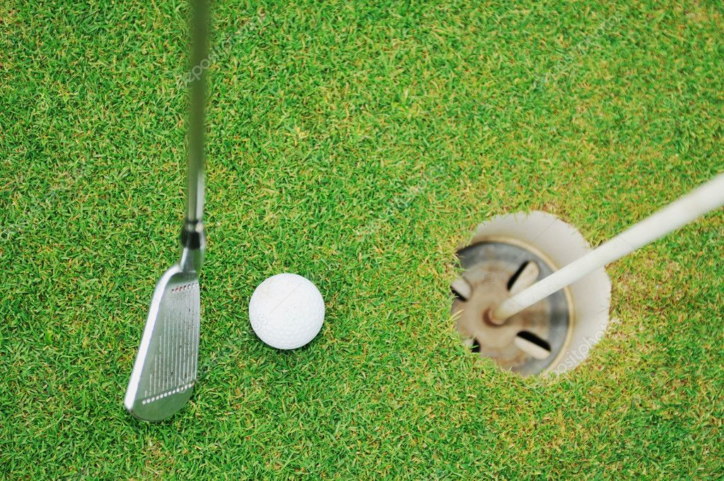 Golf ball on sports golf course and hole — Photo #1687711