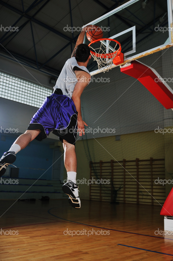 Competition cencept with who playing basketball in school gym — Stock Photo #1688037